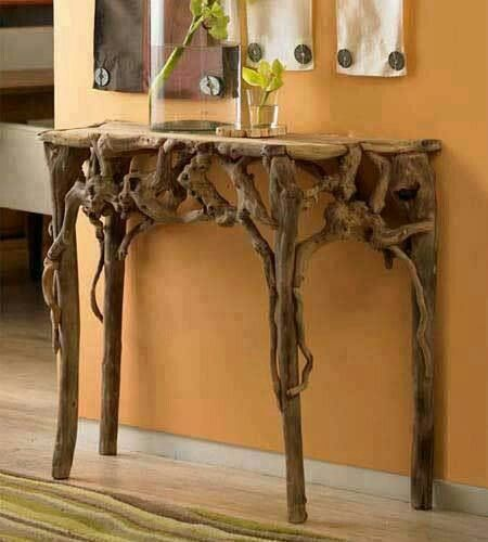 Gorgeous hall table made from tree roots.