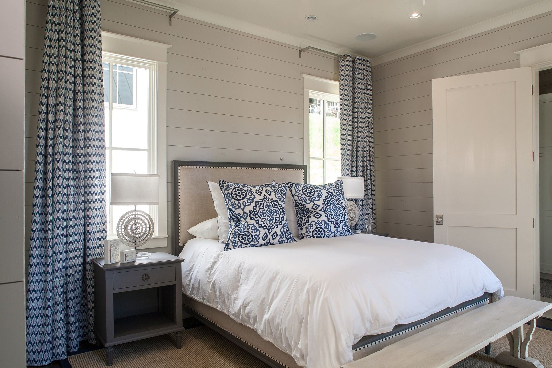 This guest room features a nautical blue-and-white color palette.