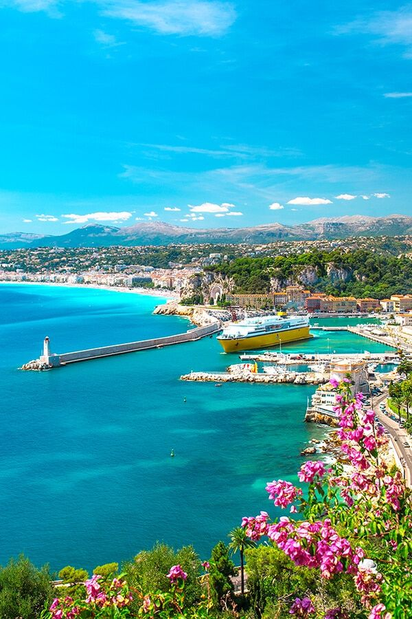 Beautiful views of Nice port with flowers in background.  This is one place you can't miss on your South of France itinerary! #provence #nice #france