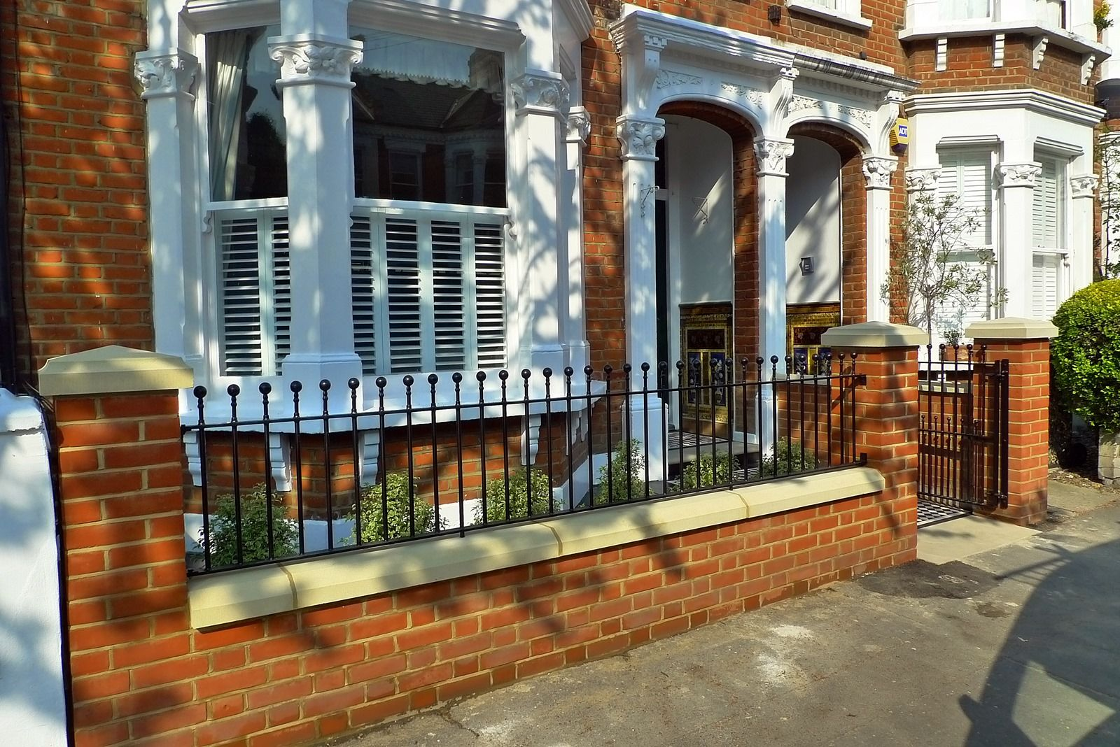 Lovely Clapham Balham Victorian Front Garden Mosaic Tile Path Red Brick Wall Black  Paving Metal Wrought Iron Gate And Rail London Round Ends On Railings