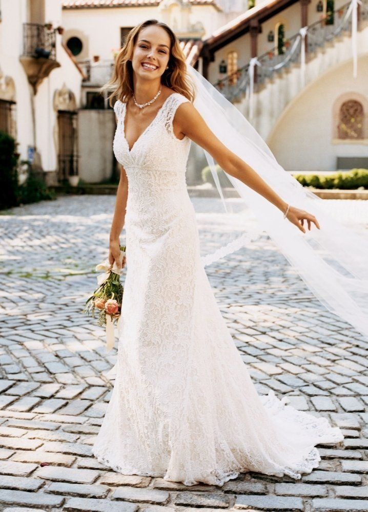 01f40a75ac Amazon.com  David s Bridal Wedding Dress  All Over Beaded Lace Trumpet Gown  Style T9612  Clothing