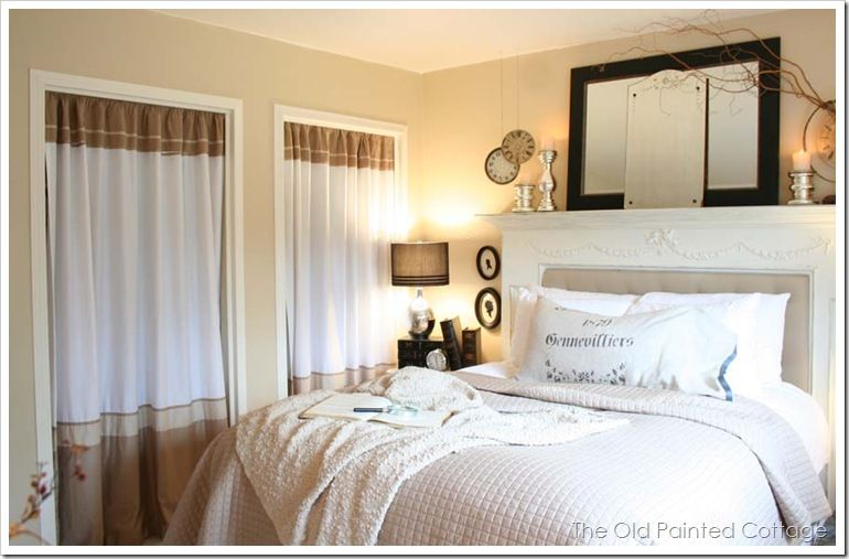 Cozy, relaxing neutral bedroom. Curtains are used as closet doors ...