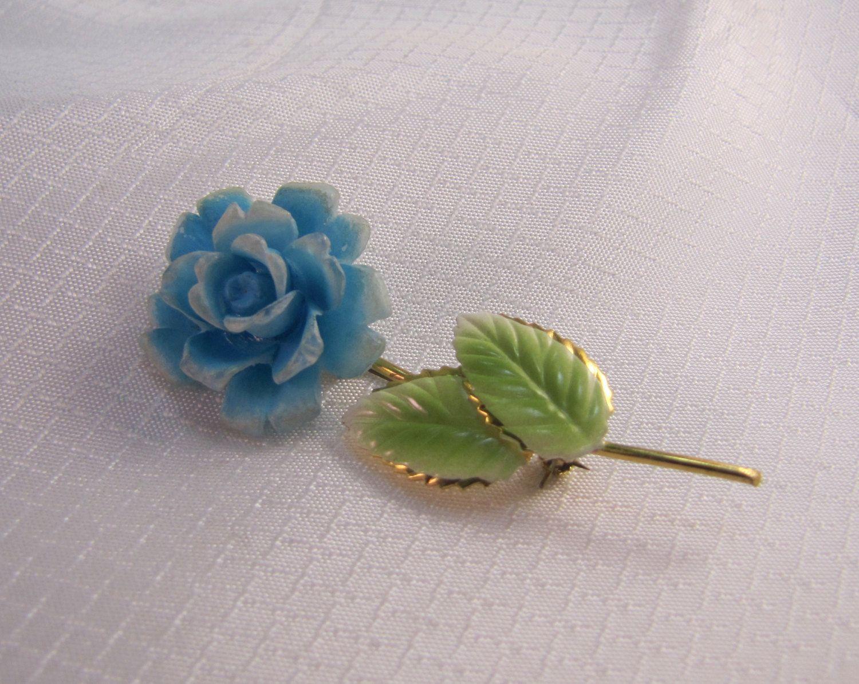 c1940's Austria Molded Flower Brooch with Enameled Leaves by newoldjewels on Etsy https://www.etsy.com/listing/265117011/c1940s-austria-molded-flower-brooch-with