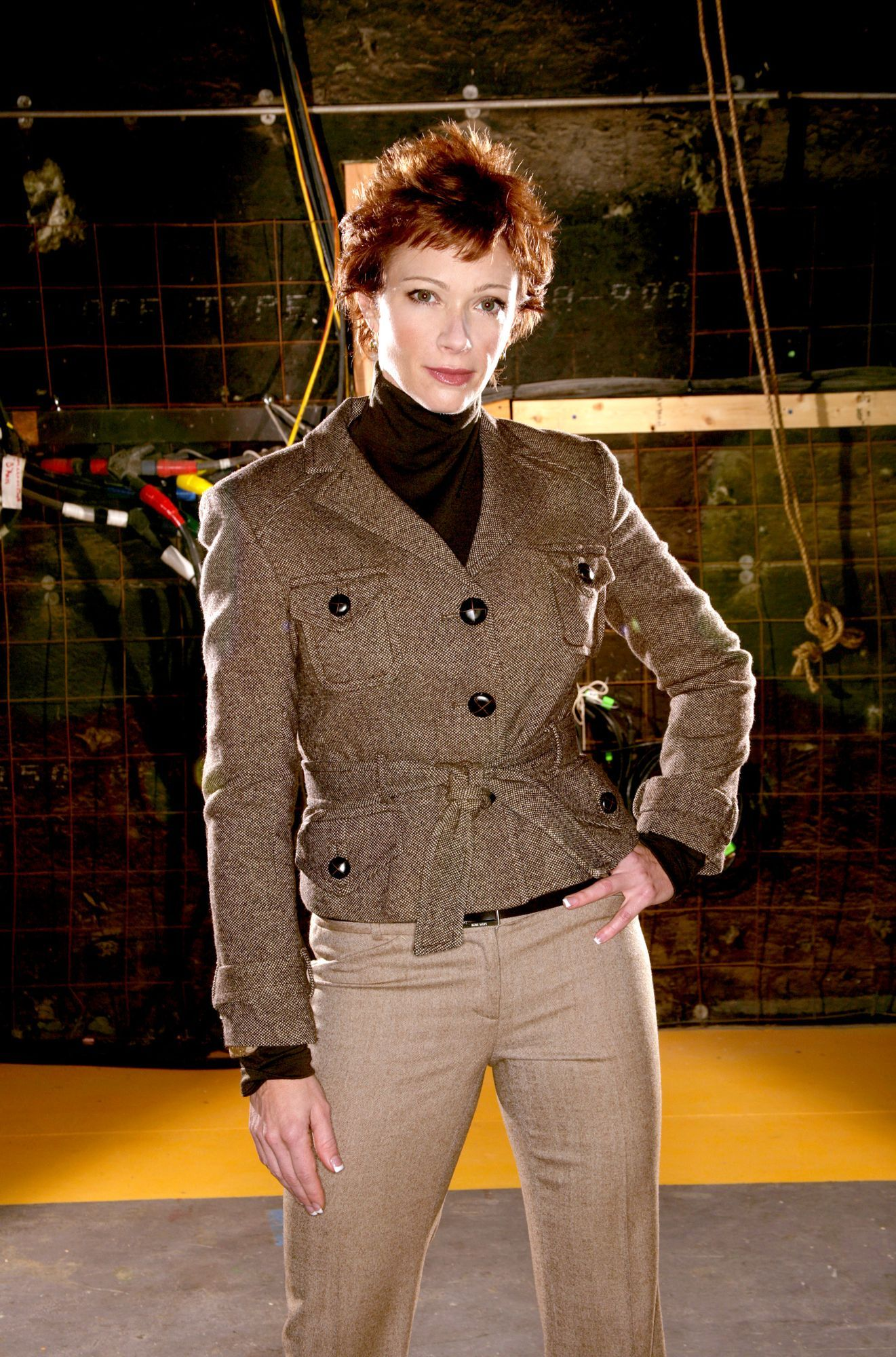 Lauren Holly, who has short red hair in this photo, plays