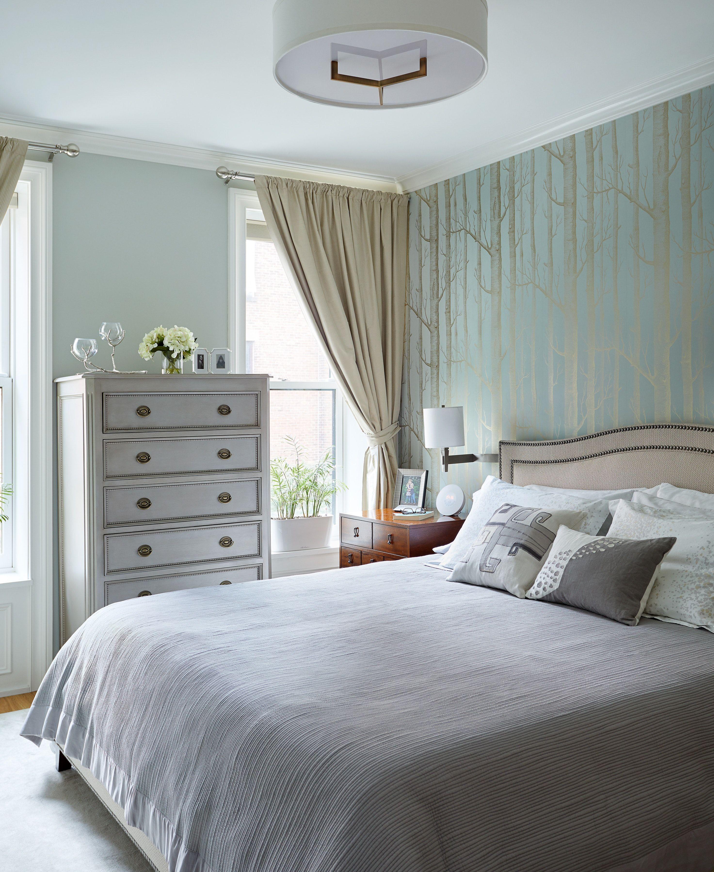 master bedroom in neutral tones with woods wallpaper
