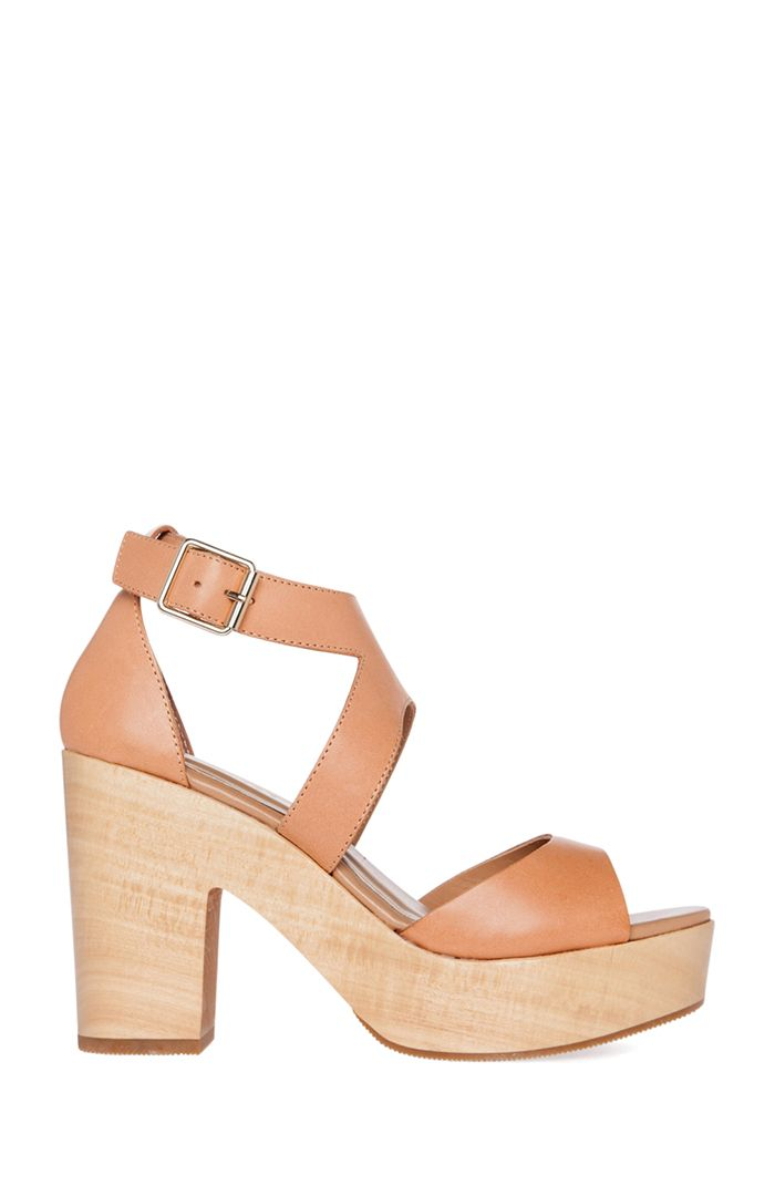 Platform sandal heels featuring a chunky heel and adjustable buckle ankle strap. By Chinese Laundry.