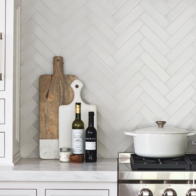 Matte Glass Herringbone Tiles Make For A Beautiful Backsplash