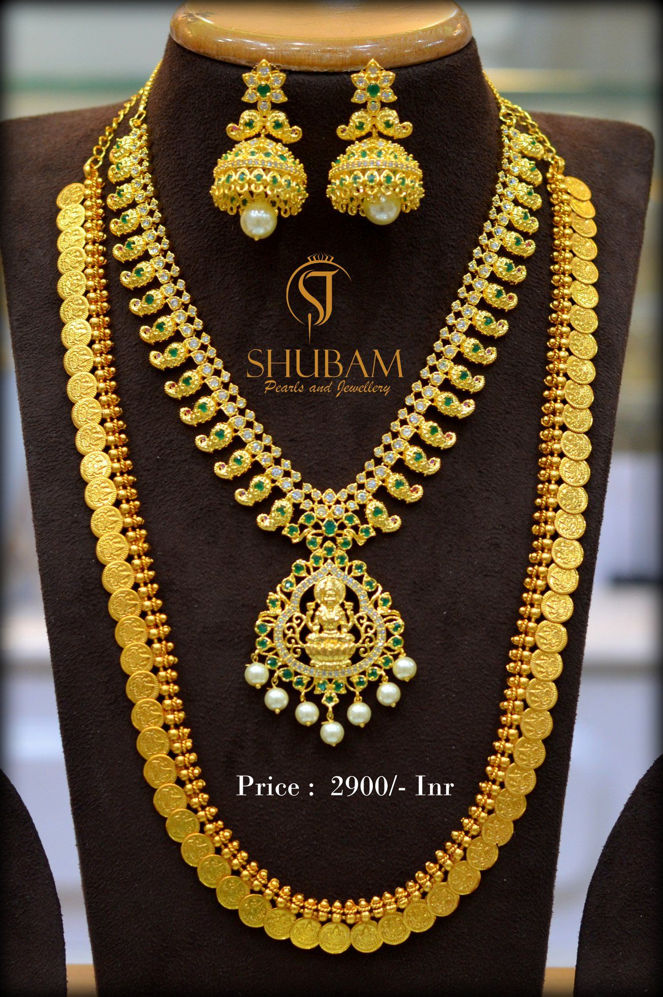 0d895491bb Beautiful one gram gold long haaram with mango design and lakshmi devi  pendant. Long haaram studded with green color stones. Long haaram with  lakshmi devi ...