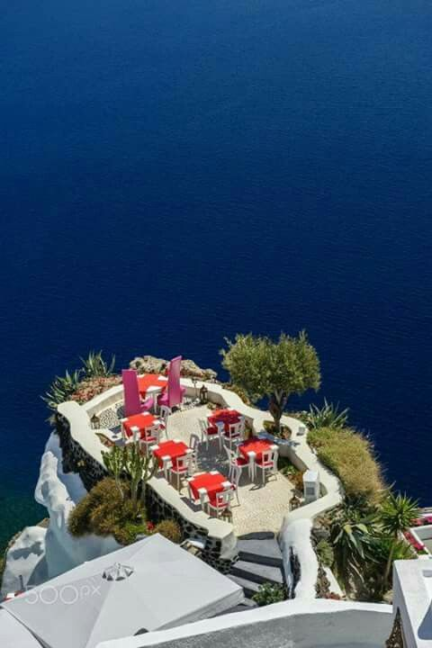 Oia, luxury outdoor cafe. What a fantastic view! Santorini, Greece.