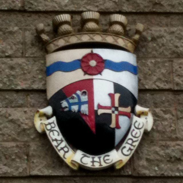 Bear the gree means to take priority and comes from Robert Burns, a man's a man for 'aw that.   Coat of arms represent Bearsden & Milngavie.  I lived in Milngavie in 1994.