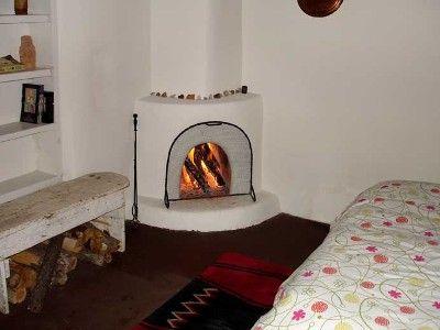 Kiva fireplace in bedroom