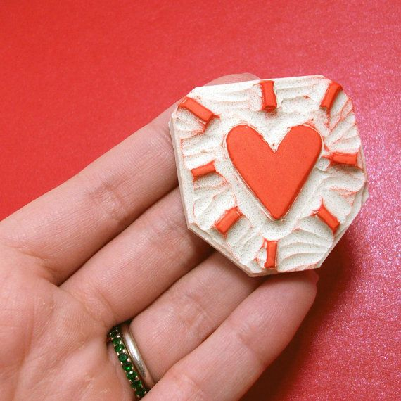 Another work by Saran Kathryn at Creatiate.  http://www.etsy.com/listing/73314944/a-heart-bursting-with-love-hand-carved