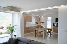 Una casa con soggiorno e cucina divisi solo quando serve ...