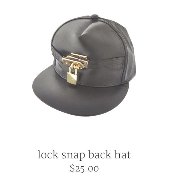 89aee283c A leather styled hat with a gold painted lock just above the bill ...