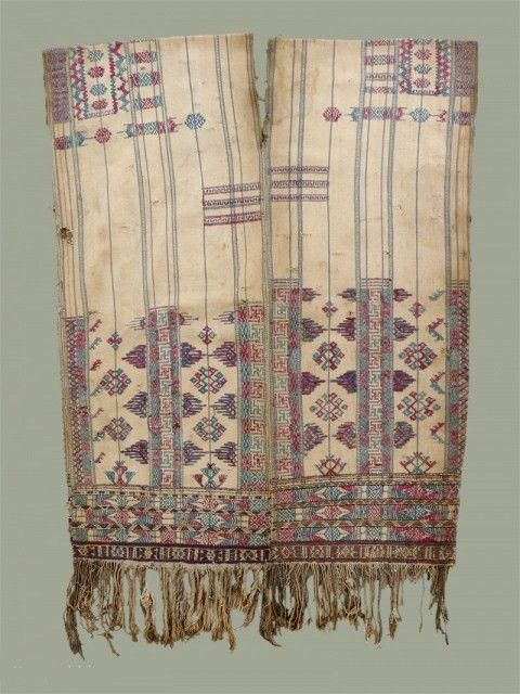 Bhutan, 'Kushung' : these old tunics are considered to be 'archaic' in design, and predate the current women's traditional dress, or 'kira' or 'kushutara'. This tunic has a array of motifs in natural colors on silk, cotton and wool on a handspun natural cotton background. Early 20th c
