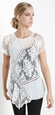 9f356317e4b Crochet lace and embroidered lace mix company on a light-as-air top in sheer  crushed fabric that finishes with a slightly angled hem.