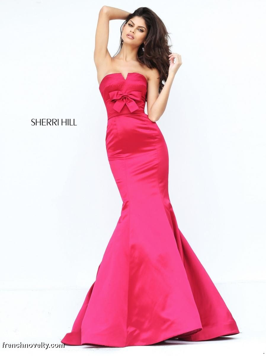 Sherri hill is a long strapless mermaid gown with a bow on