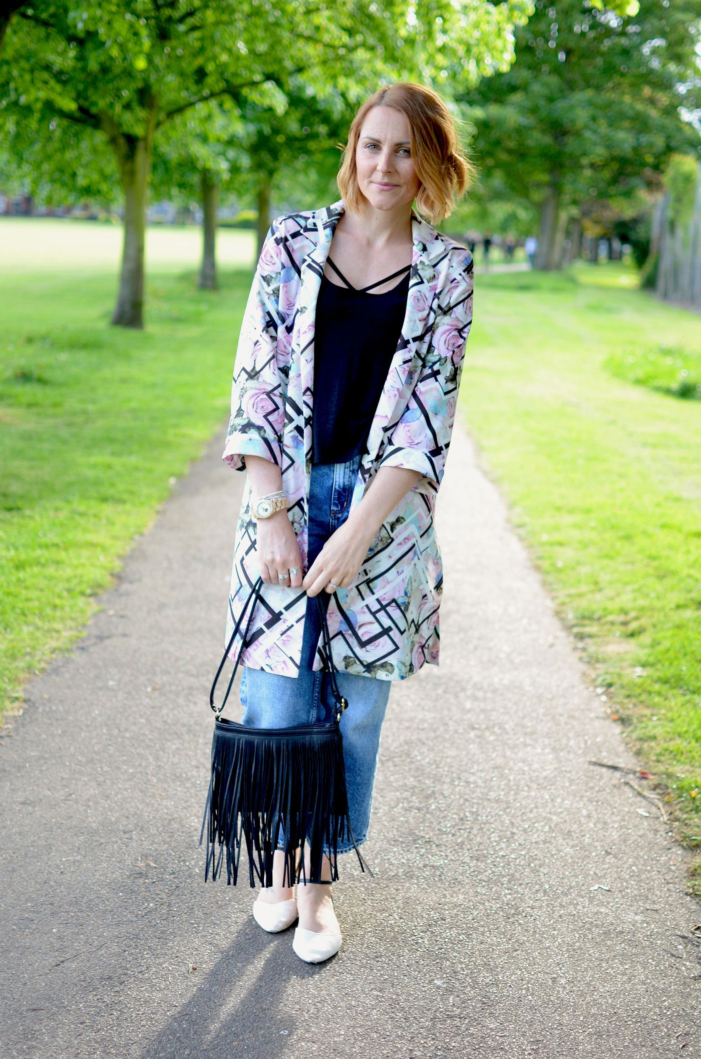 Pink duster coat and jeans