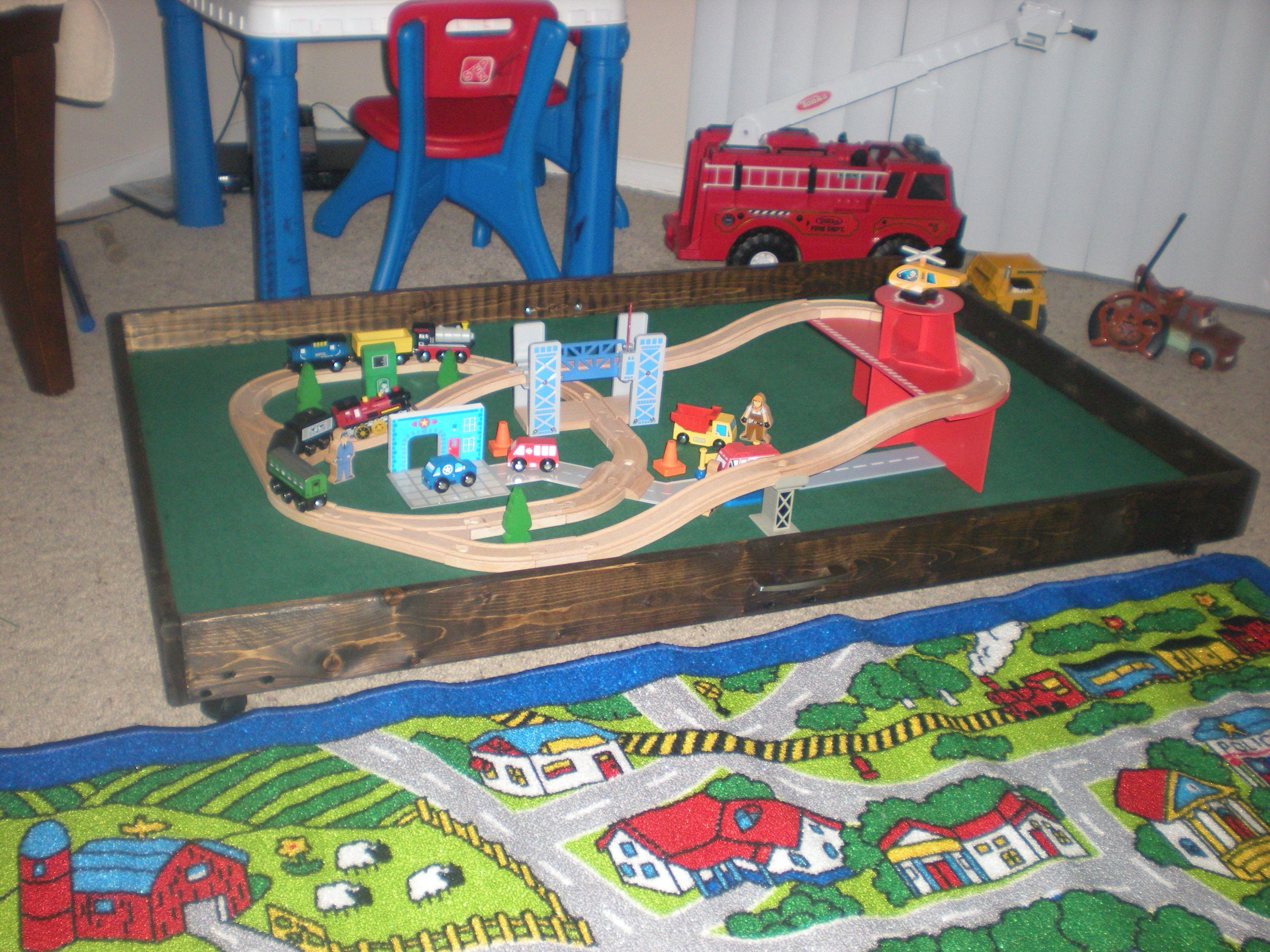 A train table that will roll under his bed...I made this ...