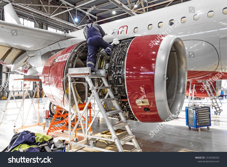 Aviation industry mechanic repairs aircraft engine jet