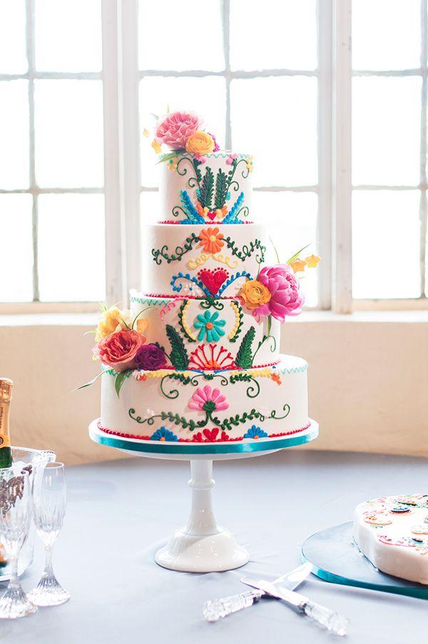 colorful festive wedding cake - photo by Ely Fair Photography http://ruffledblog.com/colorful-fiesta-wedding