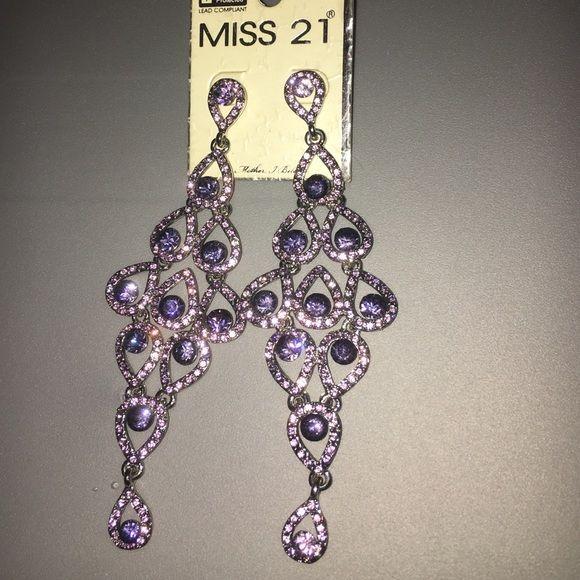 Purple dangling earrings Purple earrings. Never worn. Hang long. Jewelry Earrings
