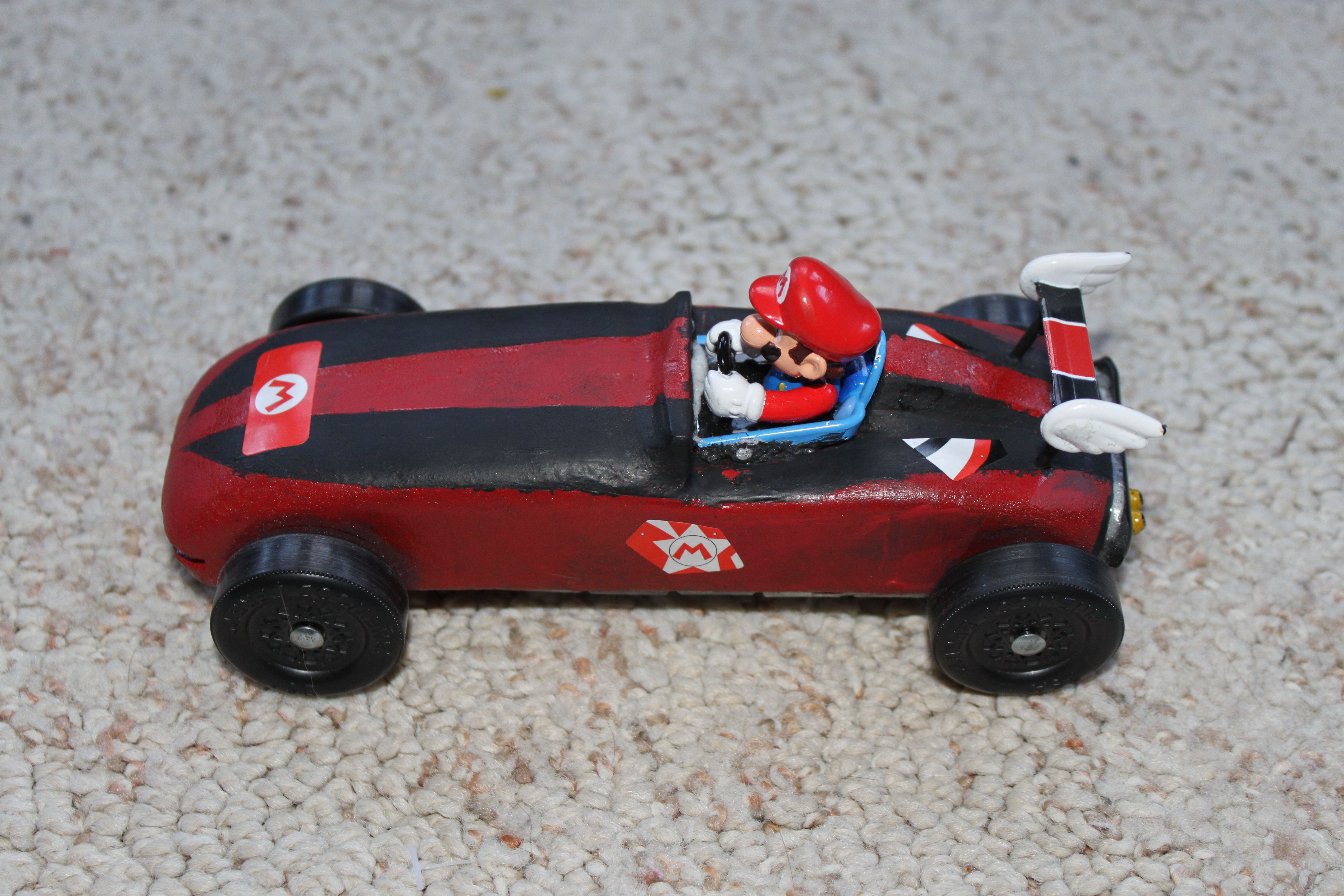 this is a picture of our mario pinewood derby car i used. Black Bedroom Furniture Sets. Home Design Ideas