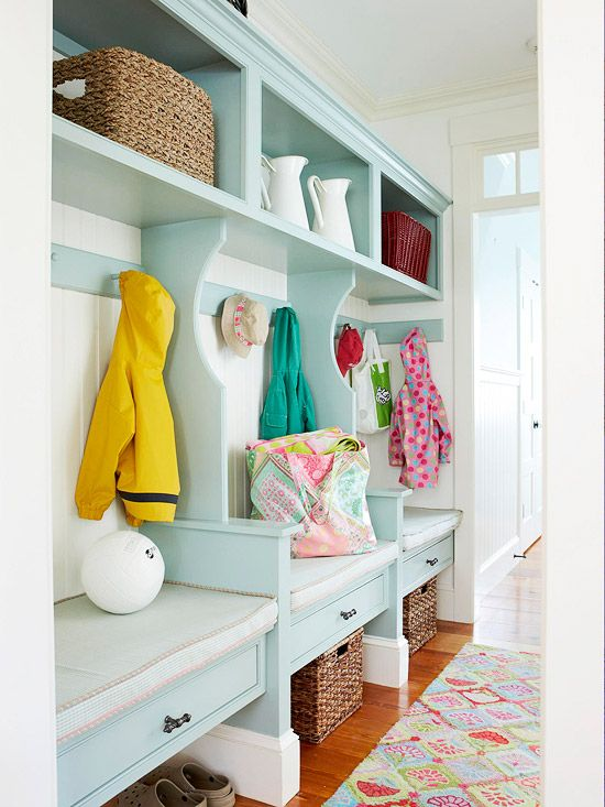this is such a cheerful mudroom that adds both beauty and function from the patterned rug to the pale aqua built ins