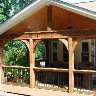 Open porch with cedar arches and timbertech composite for Open porch roof designs
