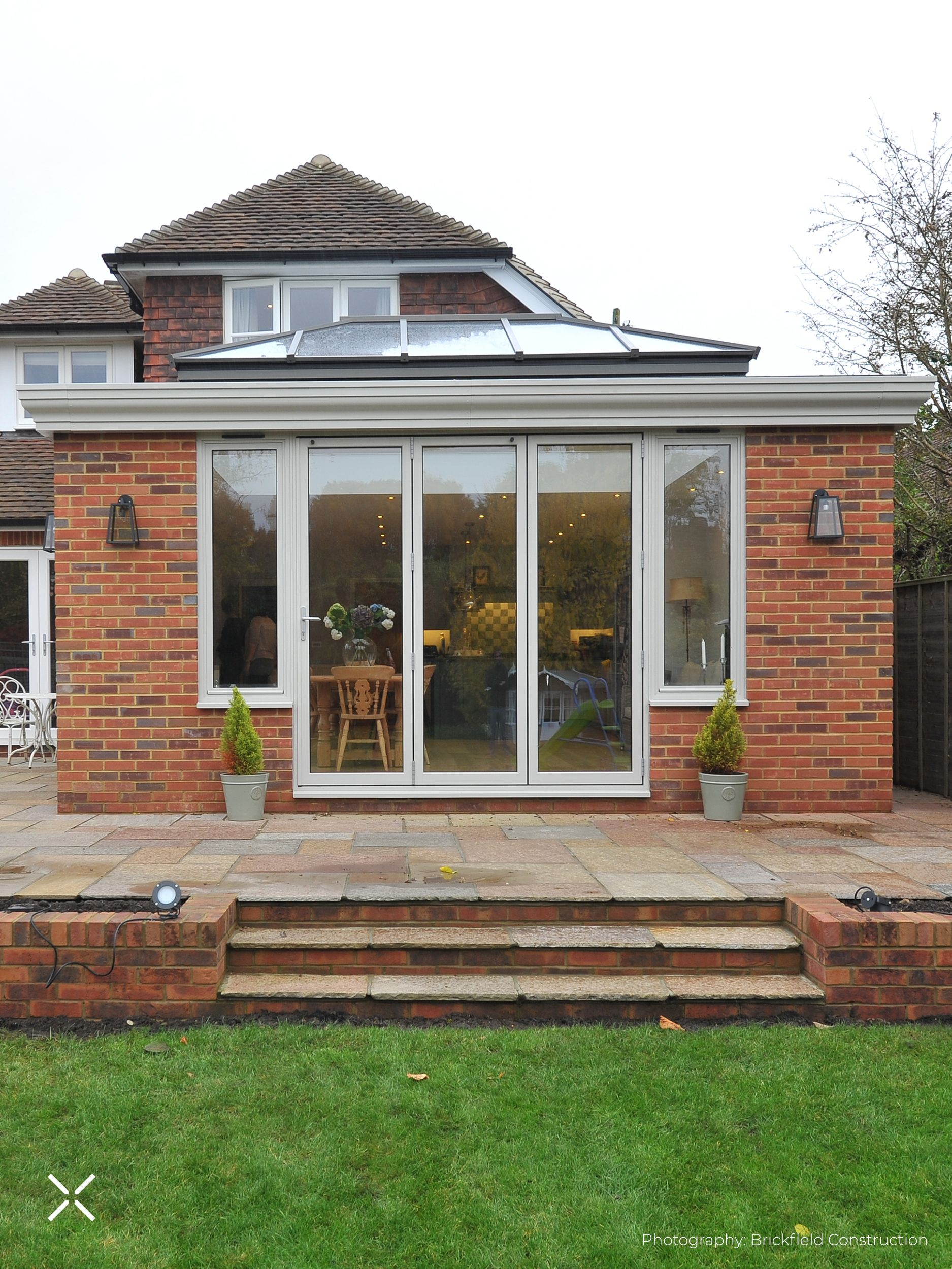 As part of a rear extension project, we supplied a range of glazing products to this home in Witley, Surrey. Including a Roof Lantern, two sets of Bifold Doors and Windows. The roof lantern was powder coated in bespoke dual-RAL colours to complement the internal and external design. The slim profiles of the roof lantern and the windows and doors adds an understated elegance to the finished look. #rooflantern #orangery #homeinspo #rearextension #improvedontmove #rooflight #aluminiumglazing