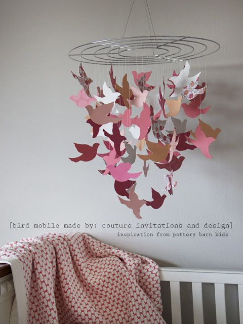 Choose a color theme to match room, one animal in a couple silhouette shapes. bird crib mobile