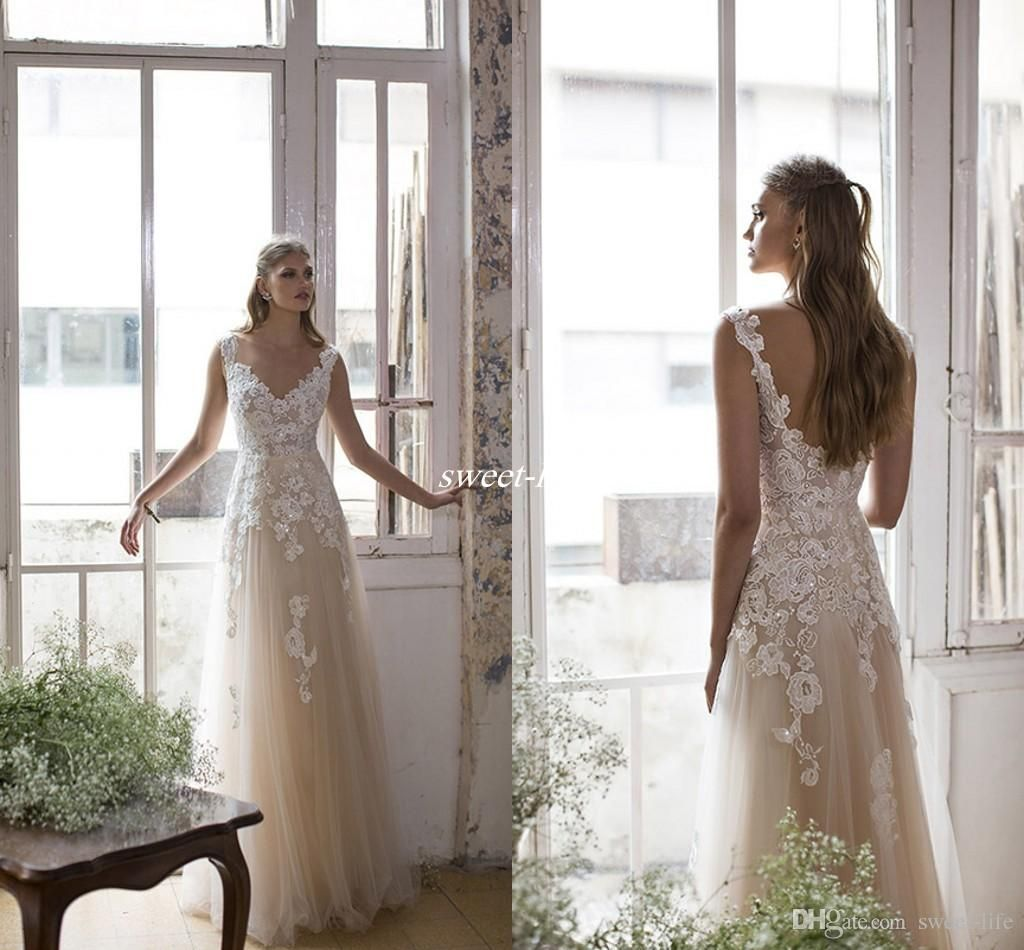 Champagne illusion lace 2017 beach wedding dresses v neck a line champagne illusion lace 2017 beach wedding dresses v neck a line tulle bridal dresses vintage sexy boho wedding gowns backless sequins cheap ombrellifo Gallery