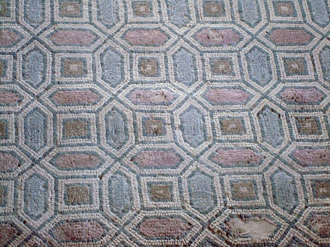 Ancient Roman mosaic floor in Carranque, Spain. Patterns are Math We Love to Look At. every wallpaper group is isomorphic – a mathematical concept meaning of the same form – to one of only 17 prototype groups.