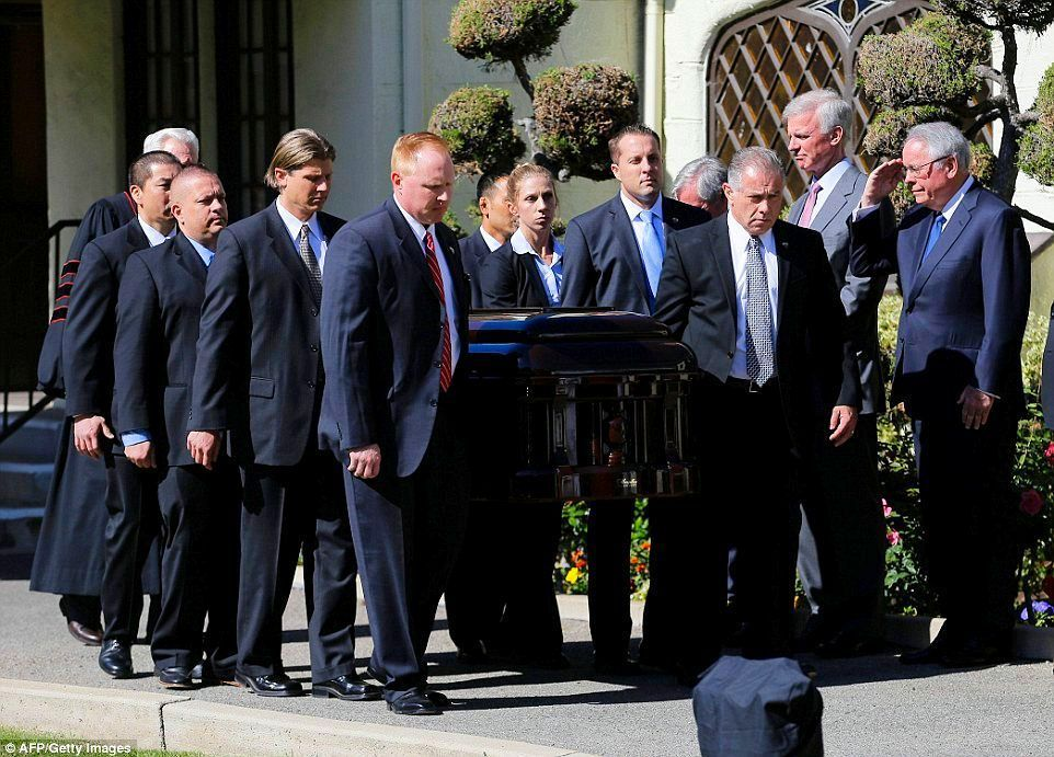 2016-03-09: Secret Service agents who protected Nancy Reagan serve as pallbearers as her casket leaves the Chapel of the Little Dawn.