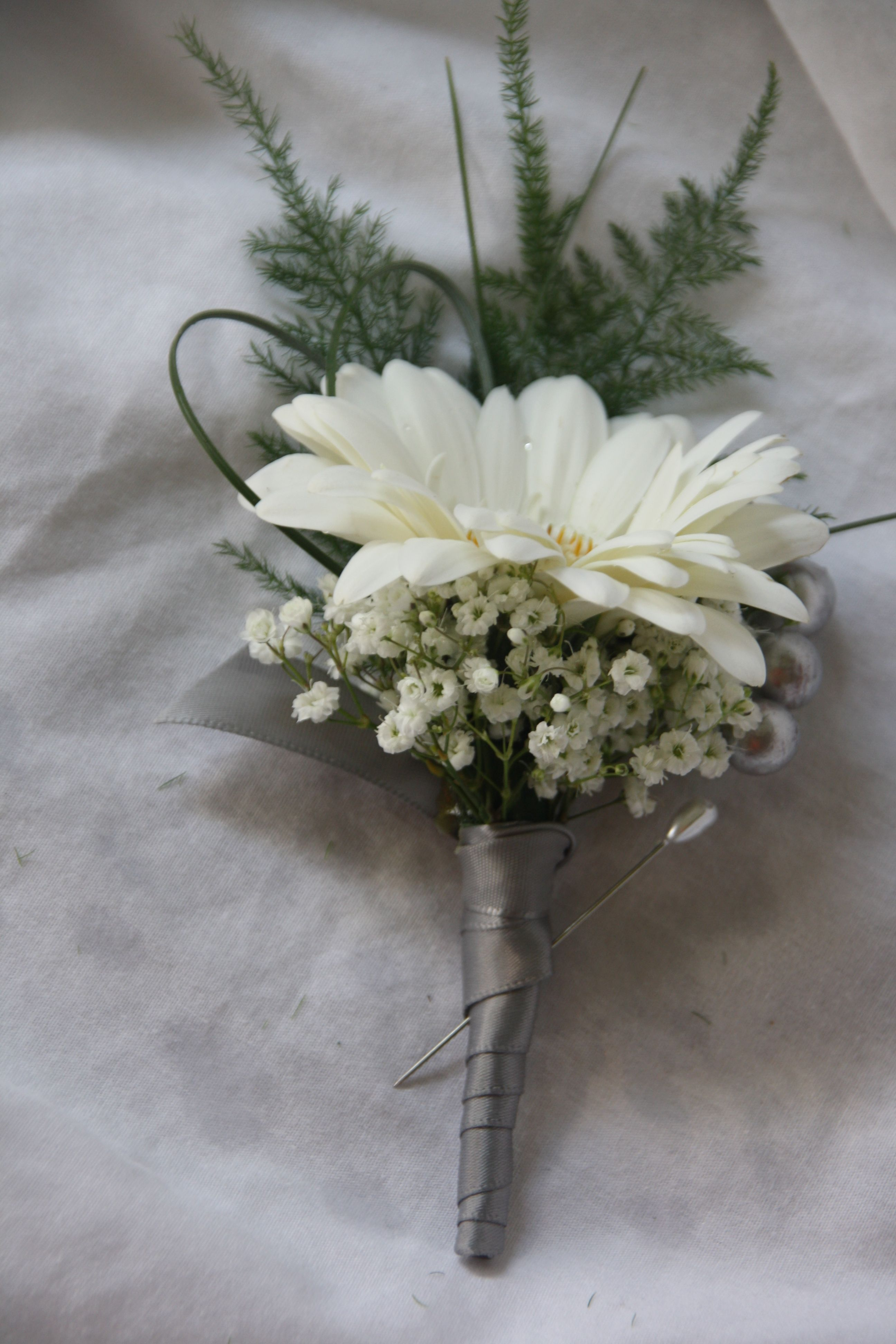 Gerber daisy boutonniere, but with blue accents instead of ...