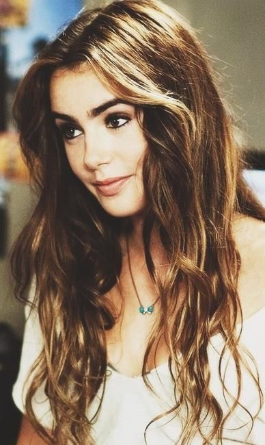 Lily Collins: brown hair   caramel highlights. Thick brows   dark ...