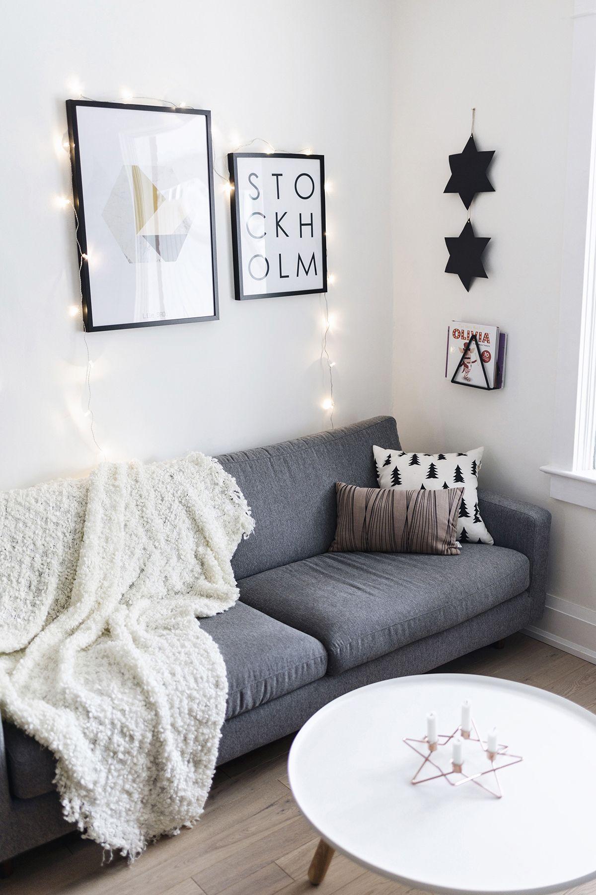 Scandinavian living room at Christmas grey sofa Normann