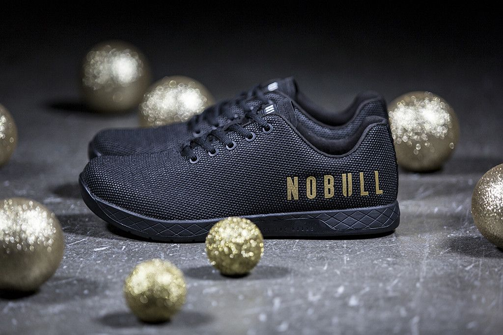 LIMITED EDITION BLACK GOLD TRAINER from