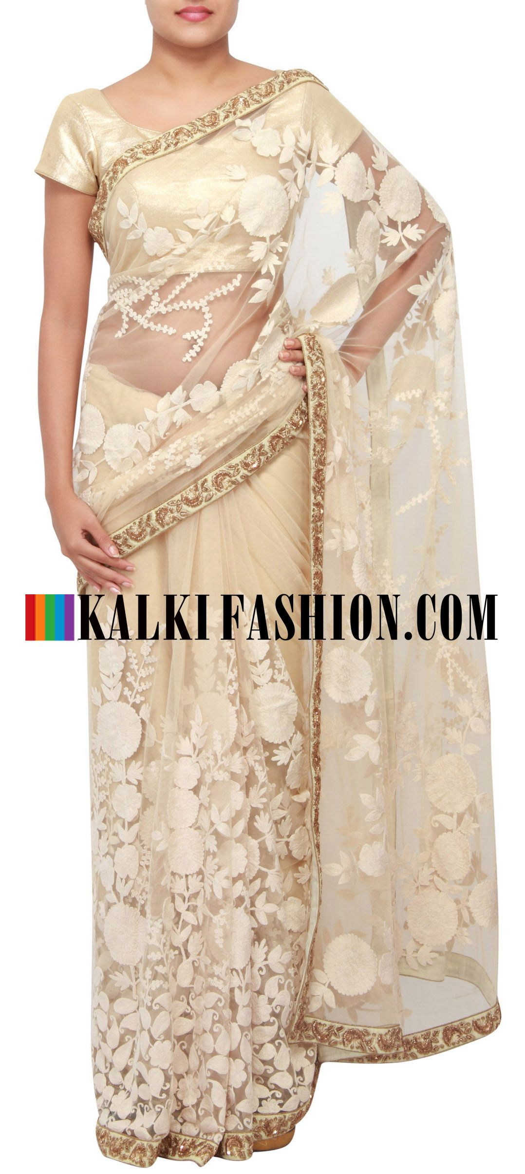 Get this beautiful saree here: http://www.kalkifashion.com/cream-saree-embellished-in-thread-embroidery-only-on-kalki.html Free shipping worldwide.