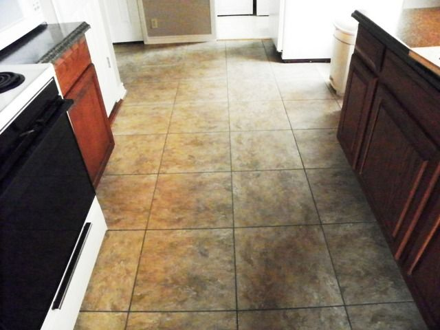 These Are 18 X 18 Vinyl Floor Tiles With Mock Grout So Looks Like Stone Love The Cost We Bought At Lowes Remodeling Mobile Homes Diy Remodel Flooring