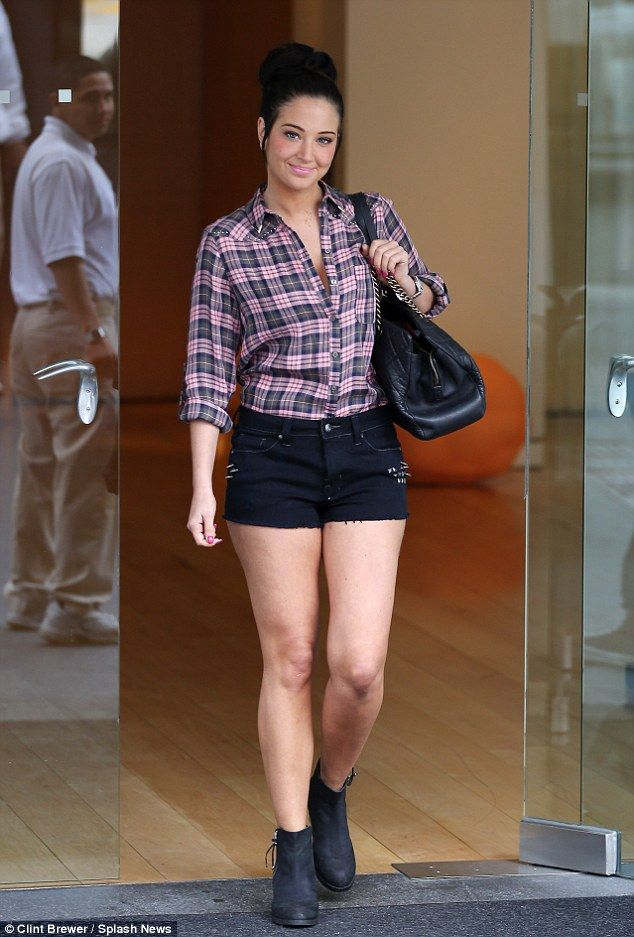 Tulisa shows off her long tanned legs in tight denim shorts after ...