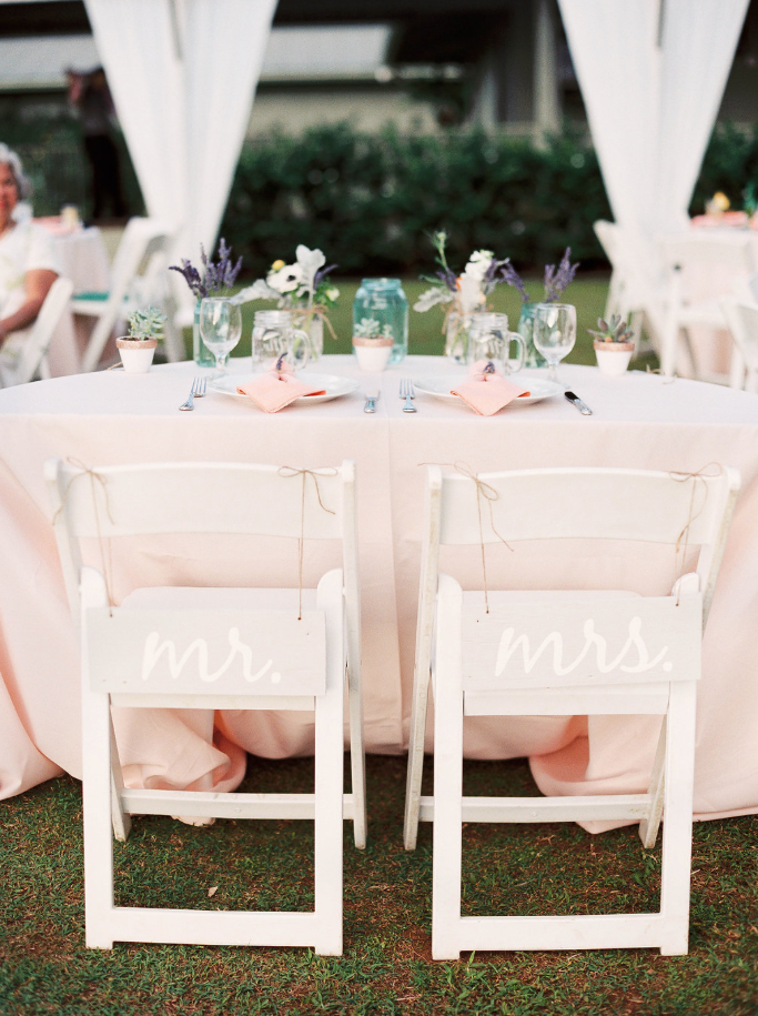 White Resin Chairs With Sweetheart Signs Ice Peach Polyester Linen On 60 Half Round Table Sweetheart Table Wedding Wedding Chairs Sweetheart Table