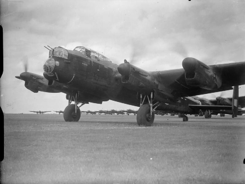 Avro Lancaster B Mark I, R5620 'OL-H', of No 83 Squadron RAF, leads the queue of aircraft waiting to take off from Scampton, Lincolnshire, on the 'Thousand-Bomber' raid to Bremen, Germany. R5620, flown by Pilot Officer J R Farrow and his crew, was the only aircraft to be lost by the Squadron that night.