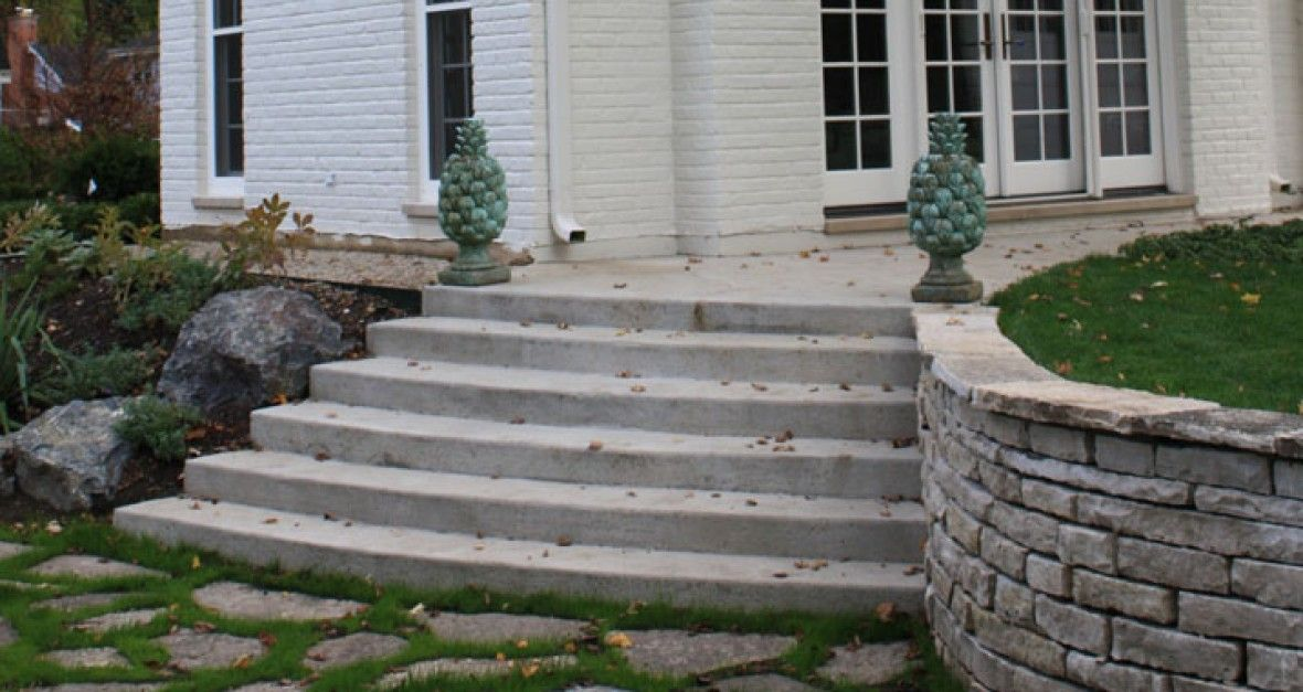 Antique Concrete Curved Staircase - nix the retaining wall on right and add modern sleek handrail