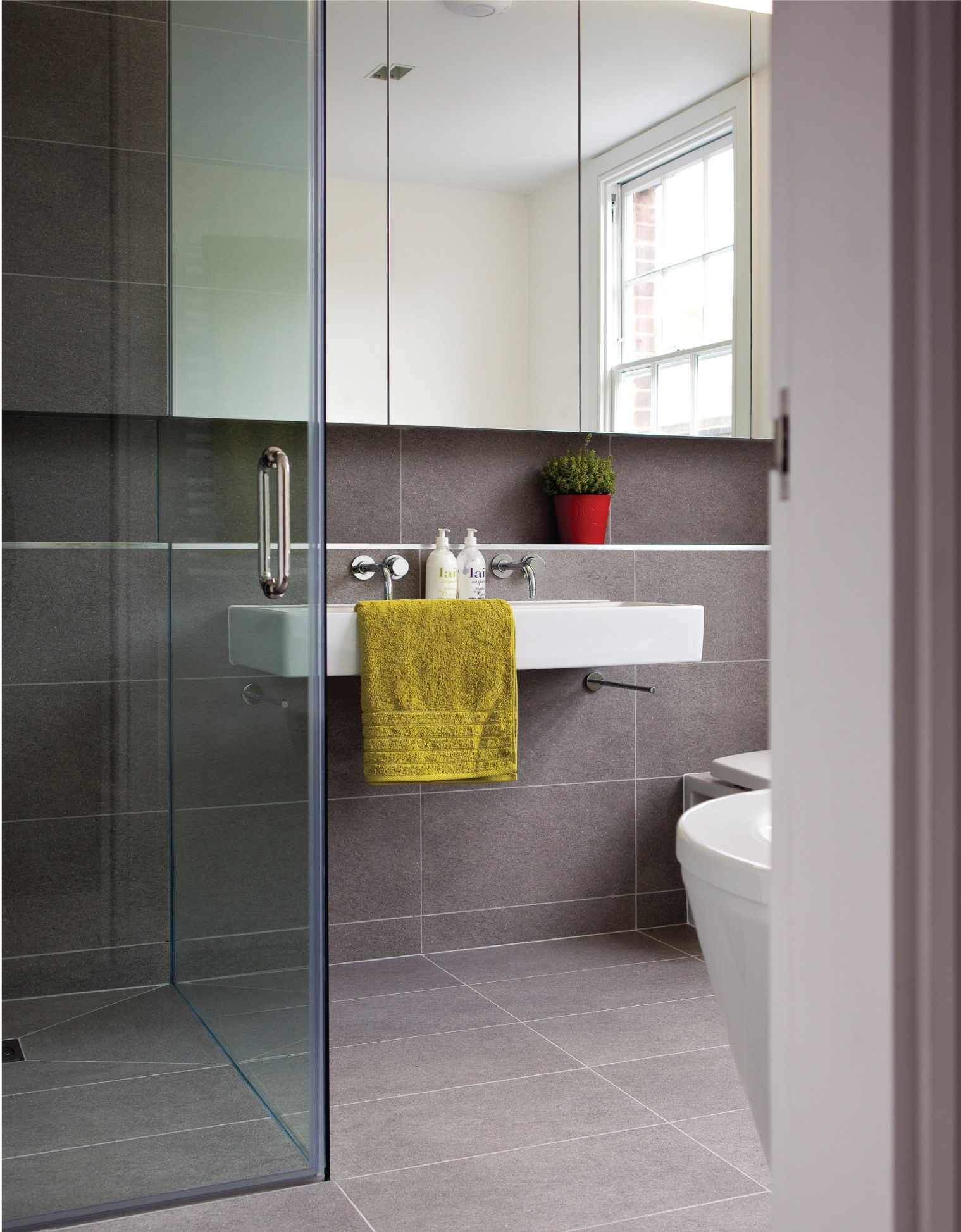 Curbless Shower With Large Format Tiles On Floor And Wall Floating Vanity