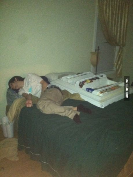 Guy passed out on bed with refrigerator door.
