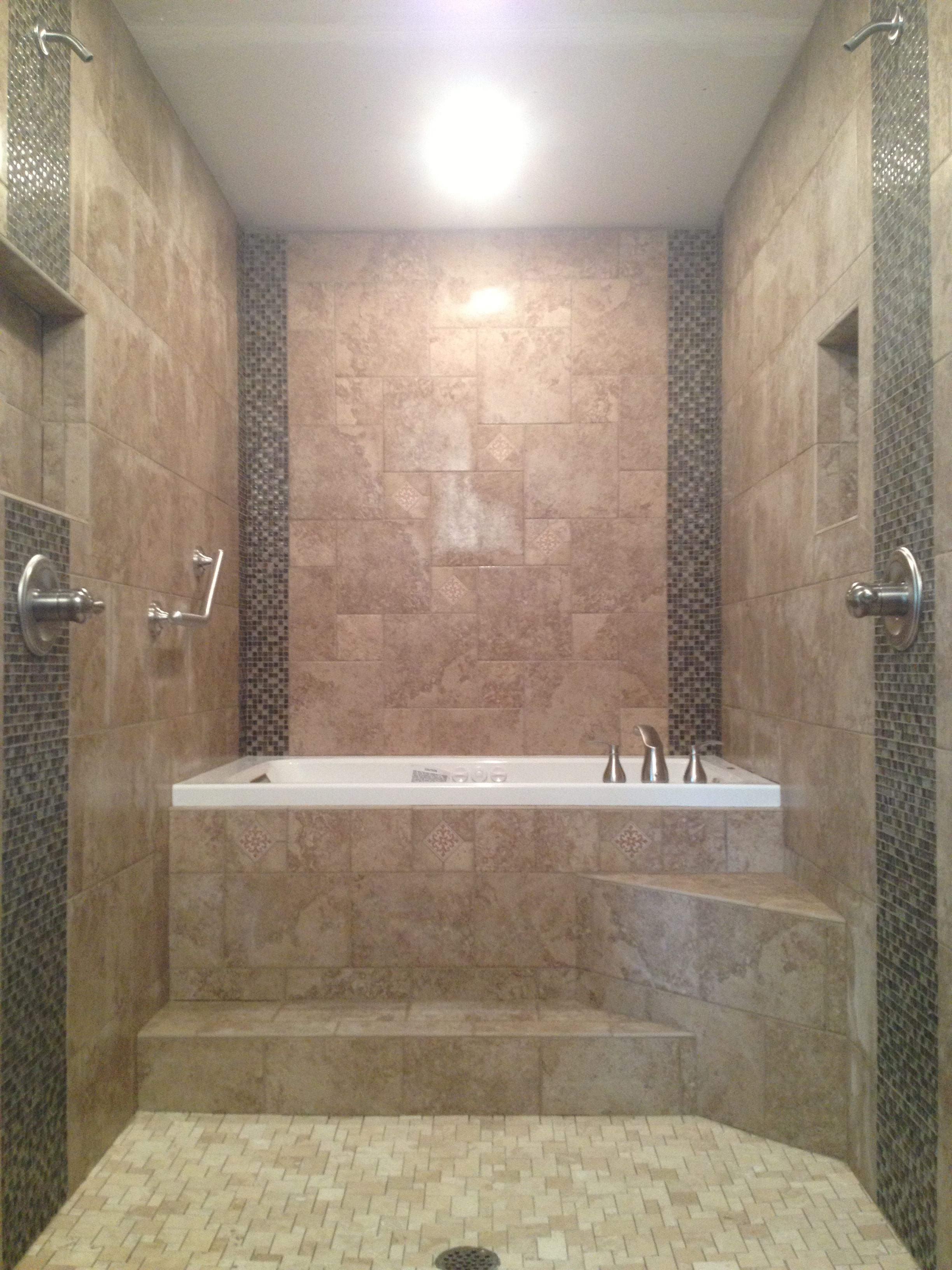 Master Bathroom renovation Walk through dual head shower to a raised drop in Jacuzzi whirlpool tub All porcelain tile with glass and natural stone mosaic