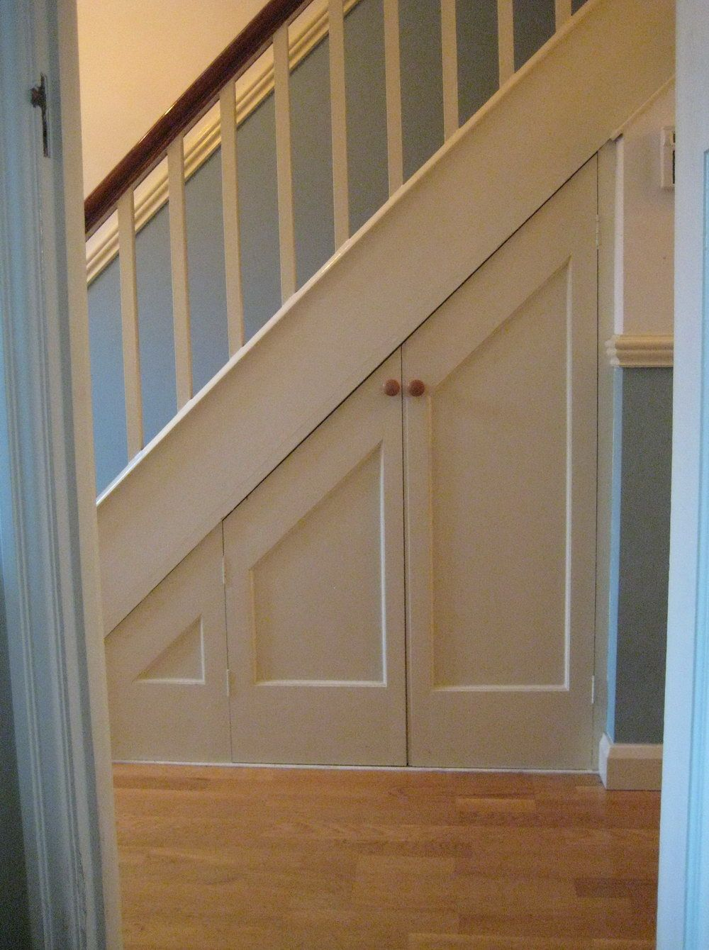 under stairs closet door under stair storage pinterest