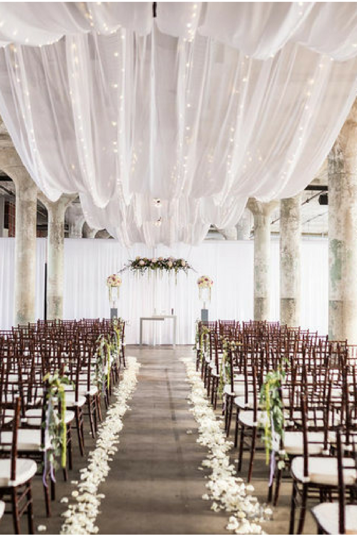 Wow Ceiling Draping Really Helped In The Transformation Of This Warehouse Space To A Beautiful Wedding Wedding Ceiling Ceiling Draping Wedding Wedding Drapery