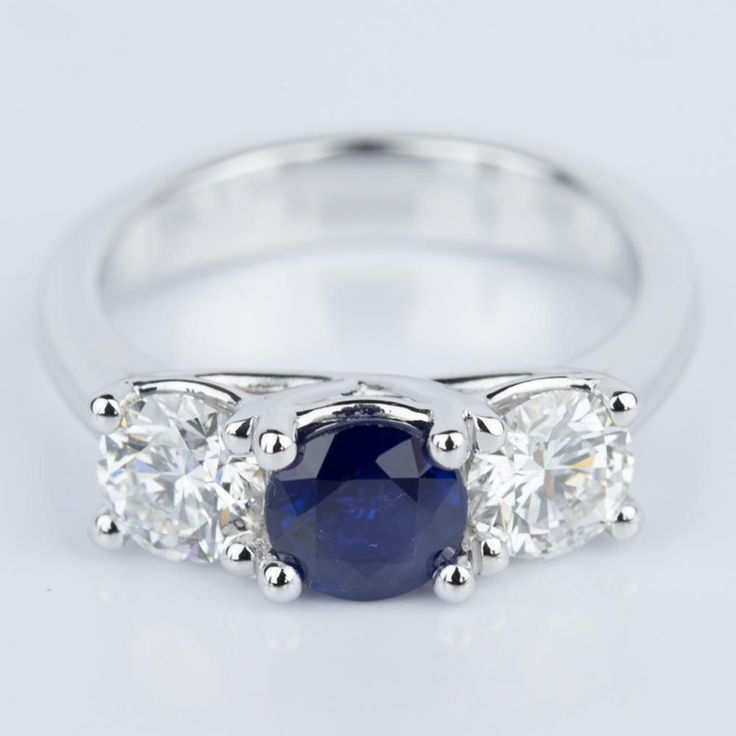 Would you say YES to this beautiful Trellis Three Stone Sapphire & Diamond Engagement Ring in White Gold?